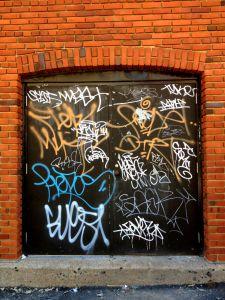 framing_street_art-tagged_door-02