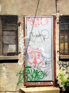 framing_street_art-tagged_door-04