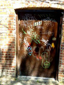 framing_street_art-tagged_door-05